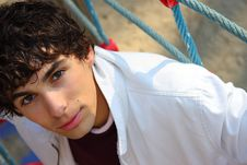 Young Adult Man In White, On A Playground Stock Images