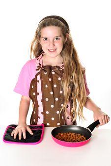Free Little Girl Toasting Almonds Royalty Free Stock Photos - 13864138