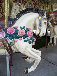 Free Rose Covered Carousel Horse Stock Images - 13865034