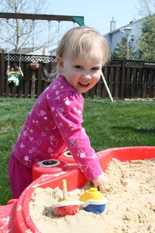Free Little Blonde Baby In Sandbox Royalty Free Stock Photography - 13865307