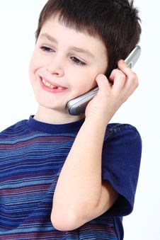 Free Smiling Small Boy Calling From Mobile Phone Royalty Free Stock Photography - 13866037