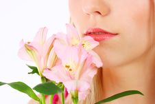 Free Portrait Of A Woman Holding Pink Flowers Stock Photo - 13868350
