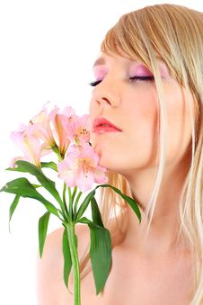 Free Portrait Of A Woman Holding Pink Flowers Stock Photos - 13868383