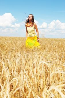 Free Beautiful Young Girl Playing On A Wheat Field Stock Image - 13868401