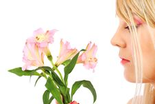 Free Portrait Of A Woman Holding Pink Flowers Royalty Free Stock Photo - 13868425