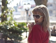 Beautiful Woman With Lollipop And Glasses. Royalty Free Stock Photography