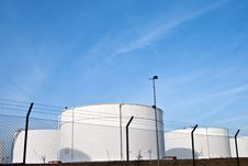 Free White Tanks In Tank Farm With Blue Clear Sky Royalty Free Stock Image - 13871386