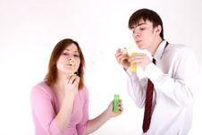 Free Romantic Couple Blowing Soap Bubbles Stock Image - 13873031