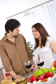 Free Happy Couple Drink Red Wine In Modern Kitchen Royalty Free Stock Photos - 13873428