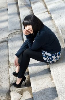 Girl Sitting On Stairs Stock Images