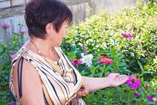 Free The Woman With Own To A Garden Stock Images - 13875334