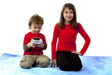 Cute Boy And Girl Sitting Royalty Free Stock Photo