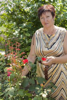 Free The Woman With Own To A Garden Royalty Free Stock Photo - 13875985