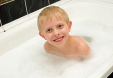 The Boy Bathes In A Bathroom Royalty Free Stock Photos