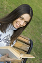 Free Female In A Park With A Book Royalty Free Stock Image - 13888606
