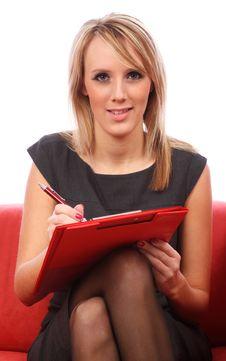 Free Women Writing In Red Folder Stock Photo - 13882180