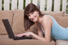Free Woman With Laptop At Home Stock Photos - 13887413