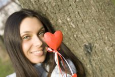Beautiful Girl With A Red Heart Stock Photography