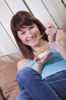 Free Woman Eating Corn Flakes On Sofa Royalty Free Stock Photo - 13887595