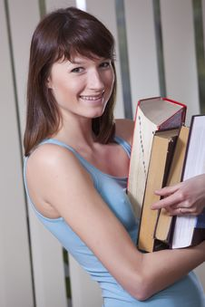 Free Female Student With Pile Of Books Stock Photo - 13887690