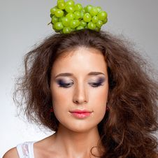 Beautiful Girl And Grapes Stock Images