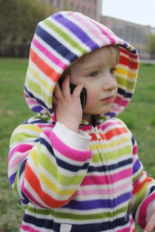 Free Little Girl Talking On The Phone Royalty Free Stock Photography - 13888017