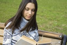 Young Woman In A Park Reading Stock Images