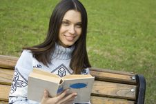 Female In A Park With A Book Royalty Free Stock Images