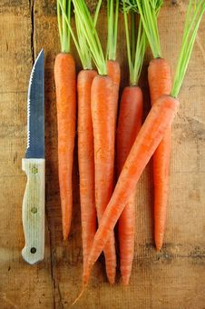Free Carrots And Knife On Wood Stock Images - 13890384