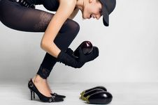 Young Girl And Eggplant Stock Photography