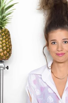 Free Young Pretty Girl And A Pineapple Royalty Free Stock Photography - 13890567