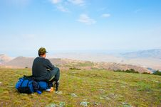 Hiker Sits On The Slope Royalty Free Stock Images