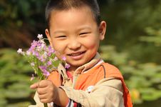 Free Boy Holding Flowers Stock Image - 13895301