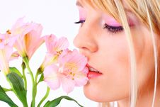Free Portrait Of A Woman Holding Pink Flowers Stock Image - 13895801