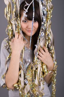 Free Girl Standing Among Tinsel Stock Image - 13898291