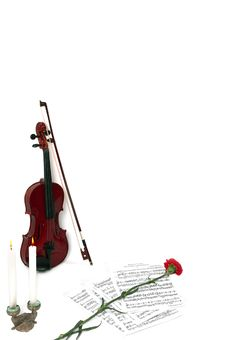 Violin Notes With Candles And Flower Stock Photos