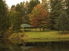 Picnic Shelter By Pond With Fall Reflections Stock Photo