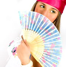 Free Beautiful Young Girl Waving A Fan Stock Image - 13904271