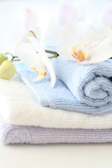 Free Orchids Over Towels Stock Image - 13904371