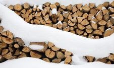 Free Firewood Stashed In Winter Stock Photos - 13904453