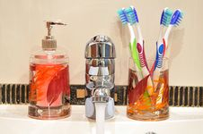 Free Liquid Soap, Faucet And Four Toothbrushes Stock Photo - 13905530
