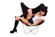 Asian Girl Lying In A Butterfly Chair. Stock Photography