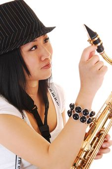 Free Chinese Girl Fixing The Saxophone. Royalty Free Stock Photography - 13907327