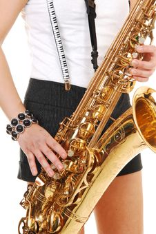 Chinese Girl Playing The Saxophone. Stock Photo