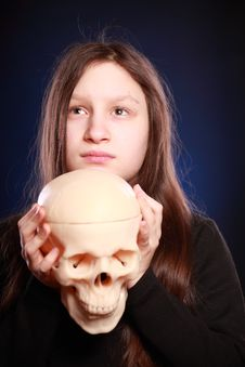 Free Teenager Girl With Human Skull Royalty Free Stock Images - 13909739