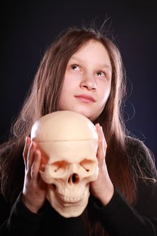 Free Teenager Girl With Human Skull Royalty Free Stock Photo - 13909785