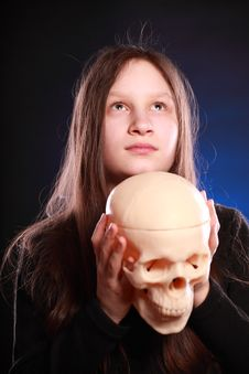 Free Teenager Girl With Human Skull Royalty Free Stock Photo - 13909795