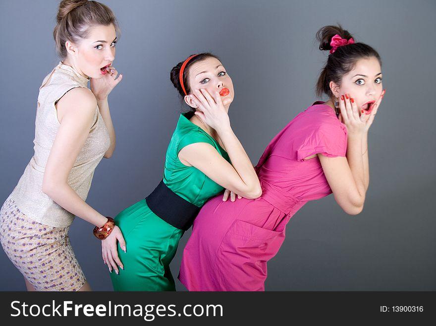 Three happy retro-styled girls