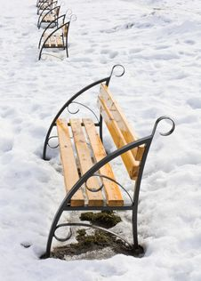 Light Brown Wooden Benches On Snow Stock Image