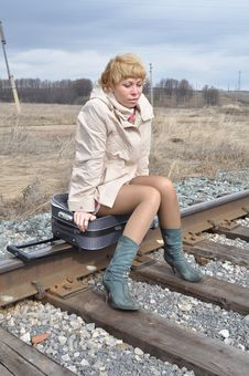 Free Woman On The Bag On The Rails Royalty Free Stock Photos - 13913078